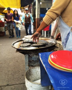 Tlacoyos- A popular Mexican Street Food. Blue Corn Masa filled with Haba beans, refried beans,, or queso. A great snack option while eating in Mexico City!