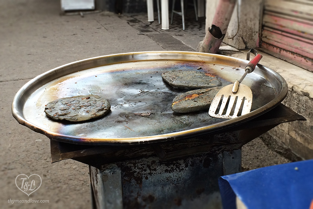 Tlacoyos- cooking on the comal in Mexico City.