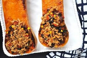 A simple + easy black bean veggie chili filled inside butternut squash boats + topped with Vegan Cheese! A hearty and satisfying meal that will even satisfy meat eaters #vegan #glutenfree