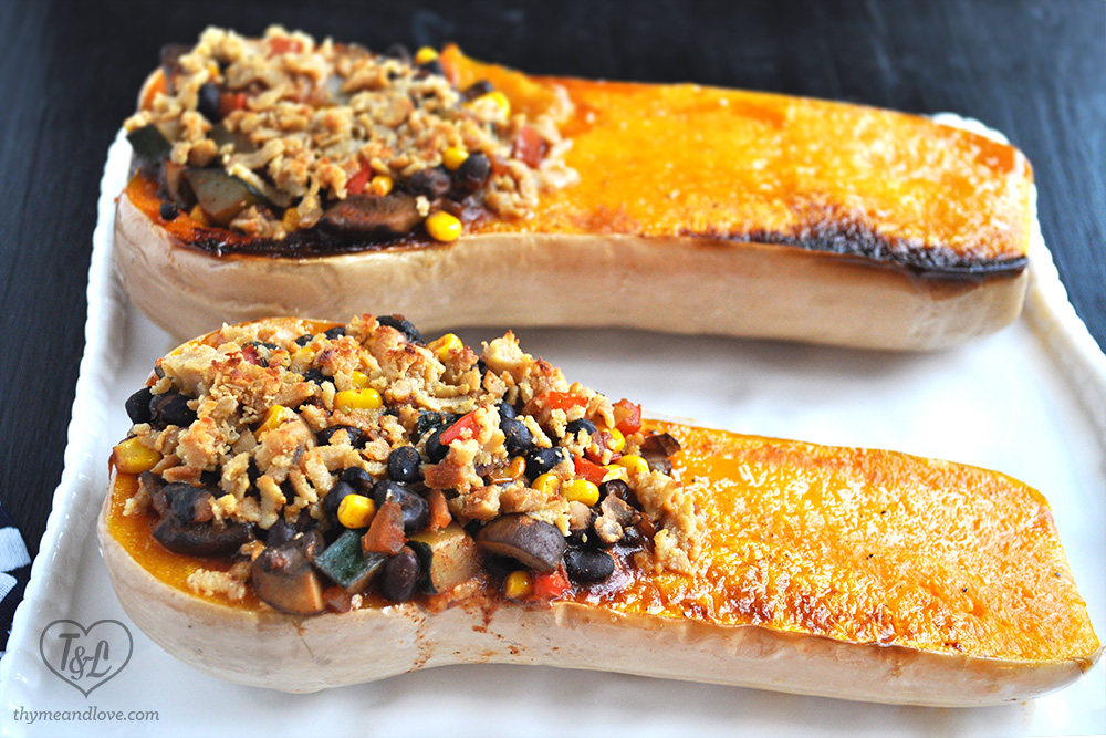 A simple + easy black bean veggie chili filled inside butternut squash boats + topped with Vegan Cheese! A hearty and satisfying meal that will even satisfy meat eaters
