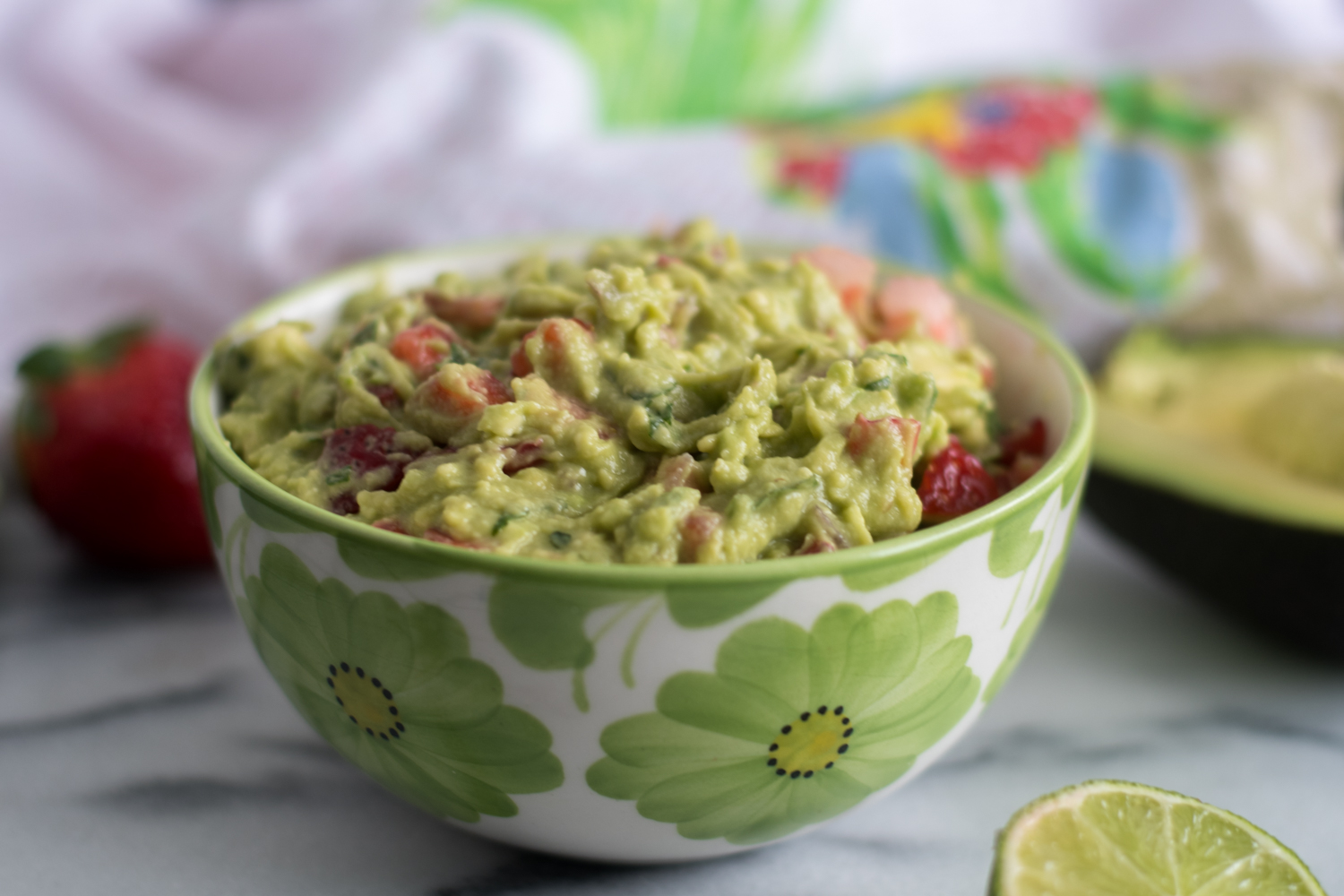 Strawberry Guacamole is a fun twist of classic guacamole. The sweet strawberries pair so well with the buttery avocado! #mexican #vegan