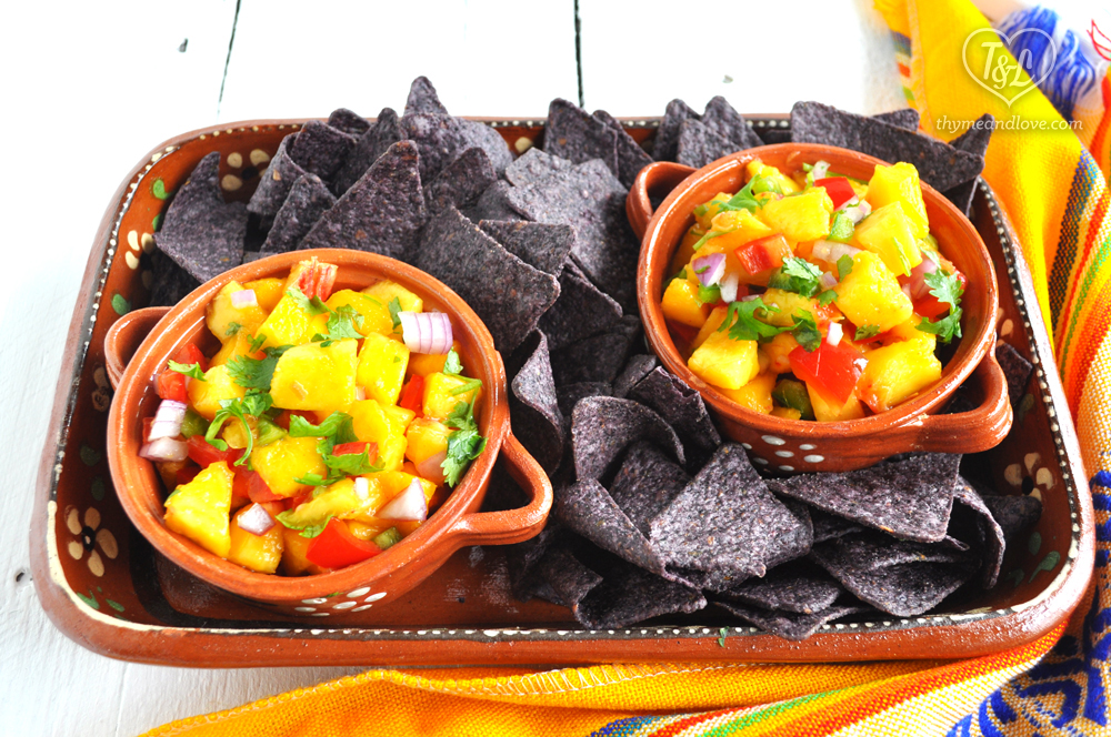 Fresh Peach Salsa is a light and healthy dip that is perfect on tacos, in salads, or just straight out of the bowl!