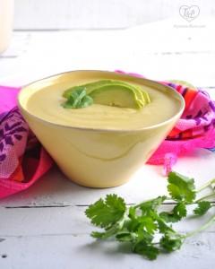 Creamy Vegan Potato Soup garnished with ripe avocado slices. Naturally Vegan + Gluten-free!