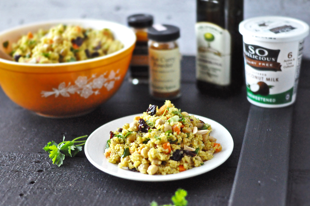 Healthy quinoa salad loaded with chickpeas, dried cherries, almonds and carrots. A curry based dressing adds a mild curry flavor, adding warmth to the salad. Naturally #vegan + #glutenfree!