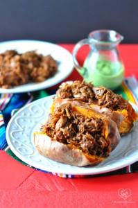 Slow Cooker BBQ Jackfruit Stuffed Sweet Potatoes with an Avocado Crema. A delicious vegan alternative to pulled pork! #vegan #bbq #glutenfree