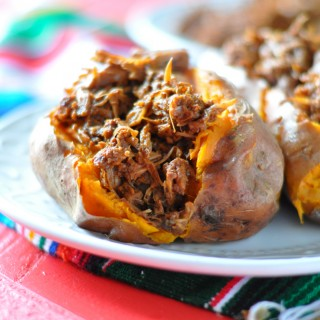 Slow Cooker BBQ Jackfruit served over baked sweet potatoes. A satisfying and healthy plant-based meal. #vegan #glutenfree