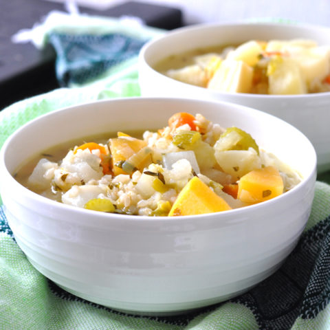 Vegan Irish Root Vegetable Stew is perfect for a healthier option to celebrate St. Patrick's Day. It's full of root vegetables and brown rice adds texture and makes this stew a complete meal! #vegan #glutenfree #recipe #stpatrick'sday