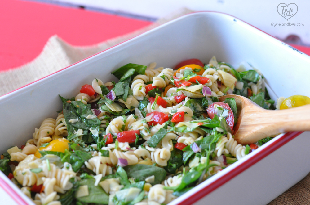 Vegan Spinach Artichoke Pasta Salad with a simple vinaigrette is perfect for any picnic or bbq! #vegan #salad #plantbased