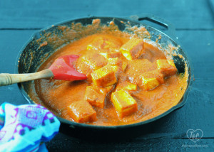 Tofu simmer in a flavorful tomato and chipotle sauce. Easy enough for a weeknight meal! #vegan #meatlessmonday #tofu #plantbased