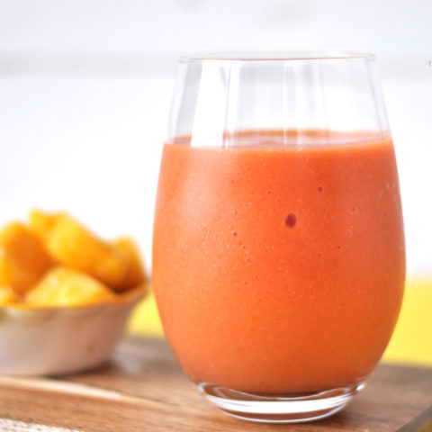 Strawberry Mango Smoothie with a hint of citrus and fresh ginger. A healthy way to kick off your morning! #smoothie #vegan #strawberry #mango #plantbased
