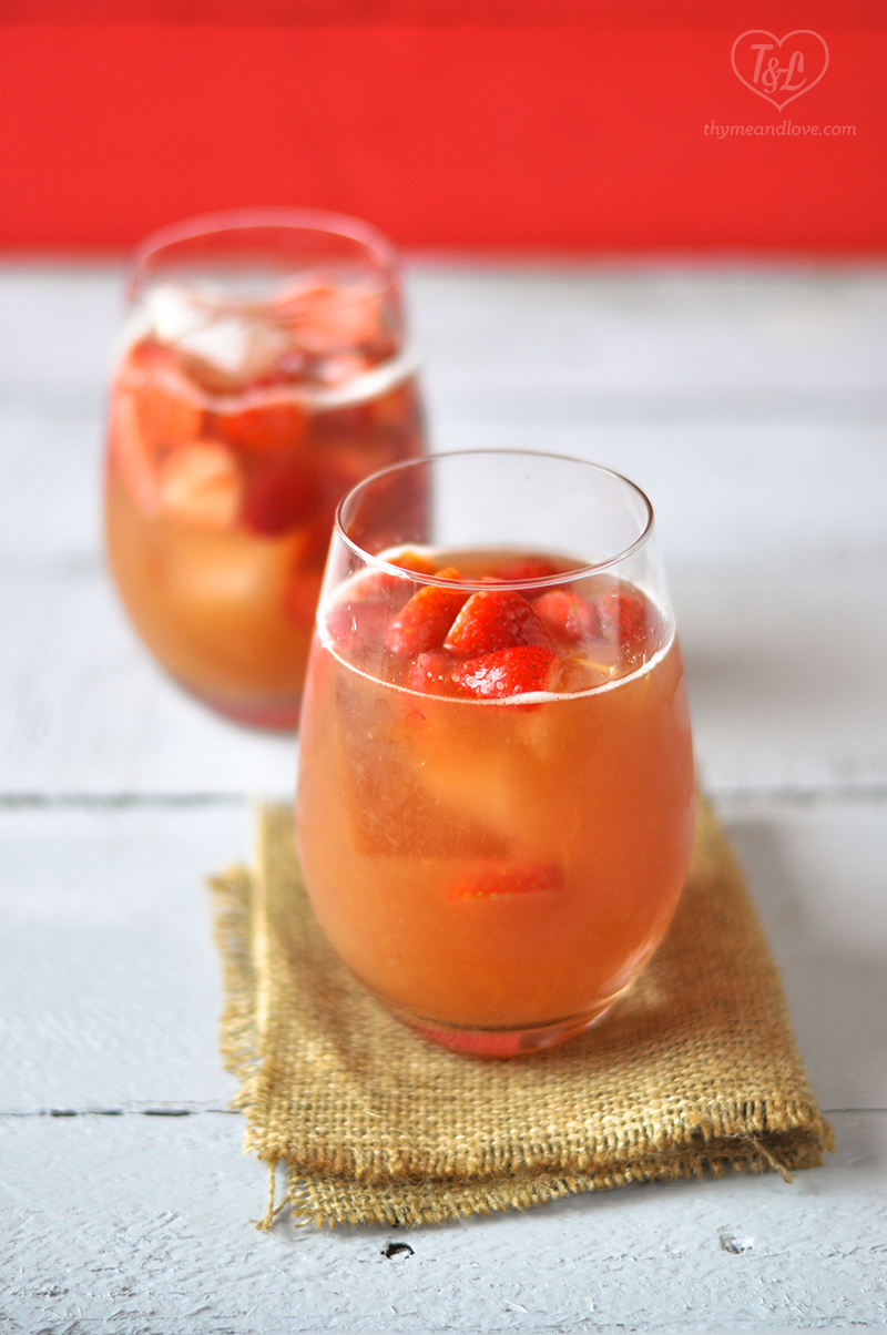Fun, summery Strawberry Rhubarb Rose Sangria is perfect for your BBQs, Picnics, and potlucks! #sangria #summer #drink
