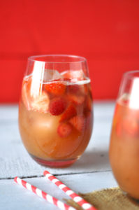 A fun, fruity drink for summer: Strawberry Rhubarb Sangria is perfect for serving at your next BBQ or picnic ! #summer #sangria #bbq #drink #rhubarb