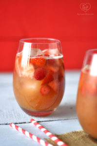 A fun, fruity drink perfect for summer. Make this Strawberry Rhubarb Rose Sangria for your next Summer BBQ! #drink #sangria #summer