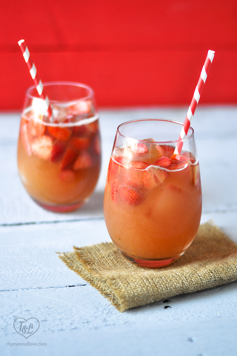 Kick off your weekend with the perfect drink for Summer: Strawberry Rhubarb Sangria! #rhubarb #sangria #memorialday #summer #drink