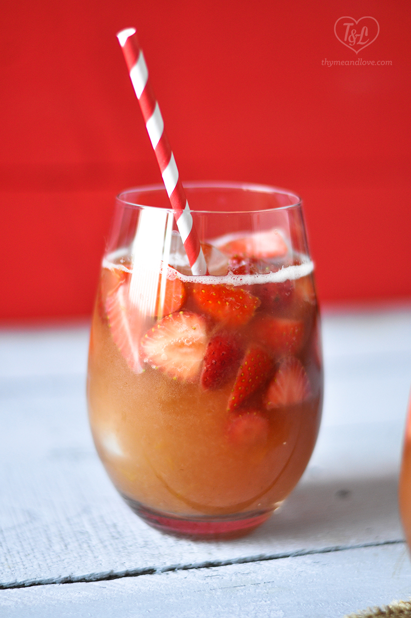 A fun, fruity drink perfect for summer. Make this Strawberry Rhubarb Rose Sangria for your next summer BBQ! #summer #bbq #drink #sangria