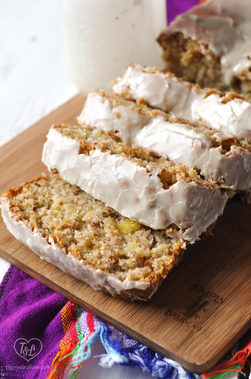 Vegan Pineapple Banana Bread is moist, tender and delicious. The bread is topped with a pineapple glaze that just takes this quick bread to the next level! #vegan #dessert #bread