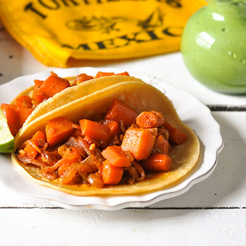 Braised Carrot Tacos are a satisfying plant-based taco filling that even meat eaters will enjoy! #tacos #meatless #veganmexican