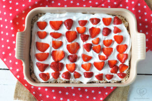 Vegan Rice Crispy Treats topped with coconut whipped cream and fresh strawberries. #summer #dessert