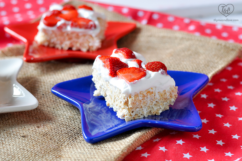 Rice Crispy Treats topped with a coconut whipped cream and fresh strawberries. Perfect for summer! #dessert #summer