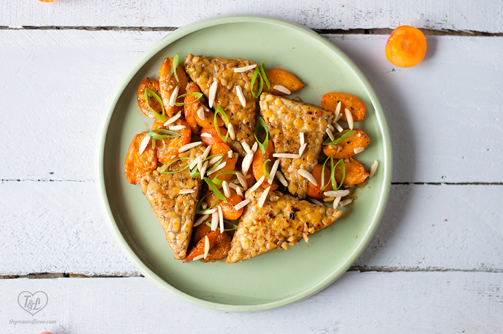 Protein packed tempeh makes a filling plant-based entree. Tempeh is simmered with fresh apricots and a white wine sauce. #vegan #entree #glutenfree