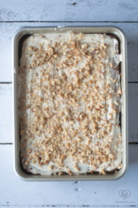 Moist, tender Zucchini Carrot Cake topped with a light cream cheese frosting and chopped walnuts.