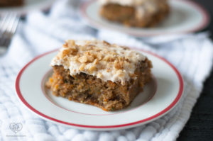 This Zucchini Carrot Cake is a moist, tender cake topped with a cream cheese frosting. Based on my Grandma's recipe. #cake #dessert #zucchini