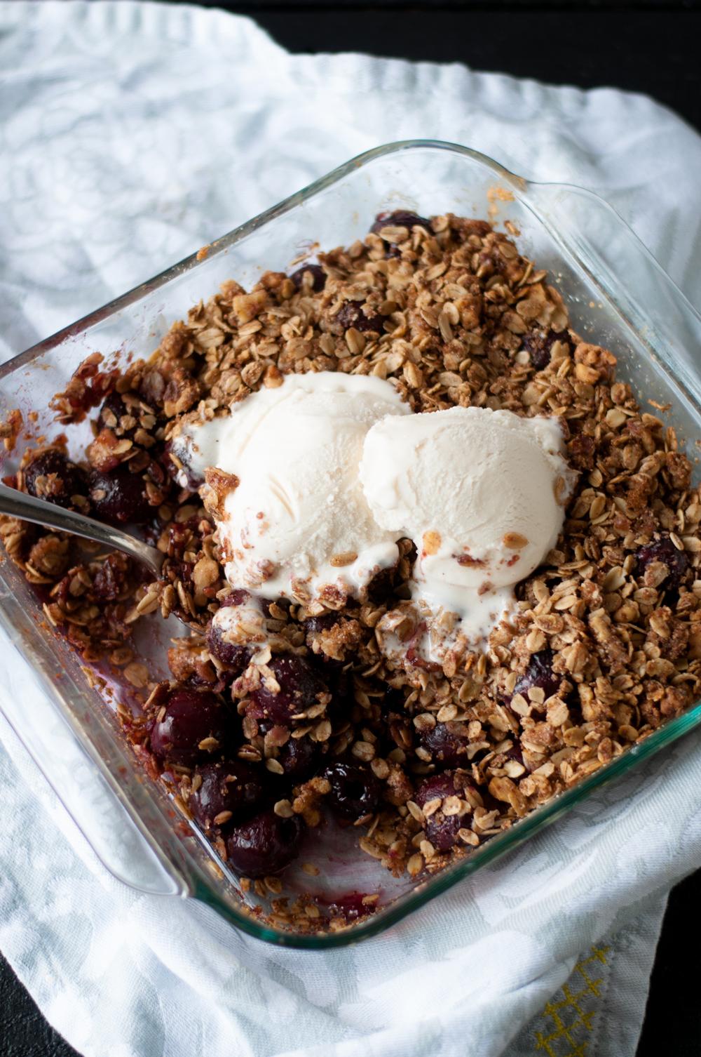 Vegan Cherry Crisp topped with ice cream is the perfect summer dessert. YUM!!! #vegan #dessert