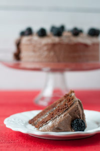 Vegan Mexican Chocolate Avocado Cake with a chocolate buttercream frosting and topped with blackberries! #cake #dessert