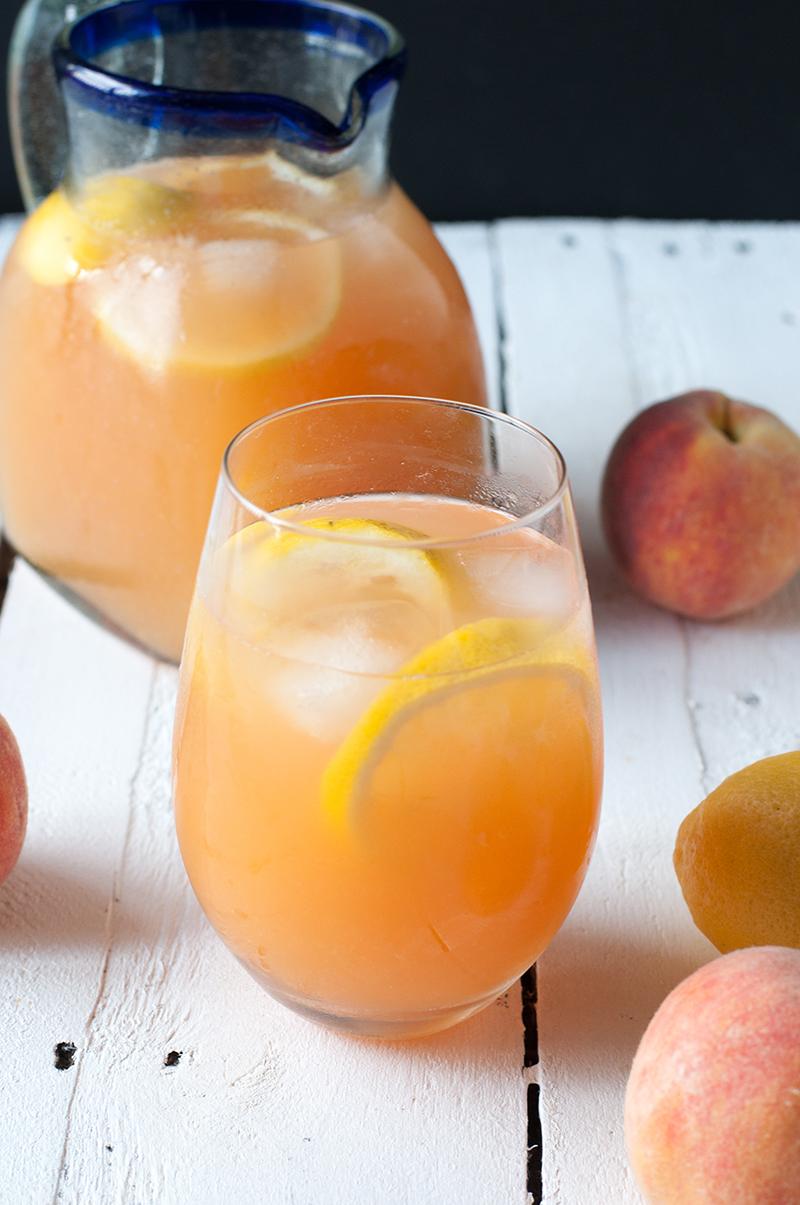 Enjoy a glass of refreshing Ginger Peach Lemonade on a hot, summer day. #drink #summer