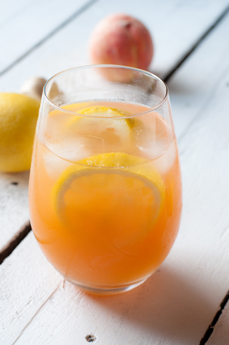 Enjoy a glass of this refreshing Ginger Peach Lemonade on a hot, summer day! #drink #summer