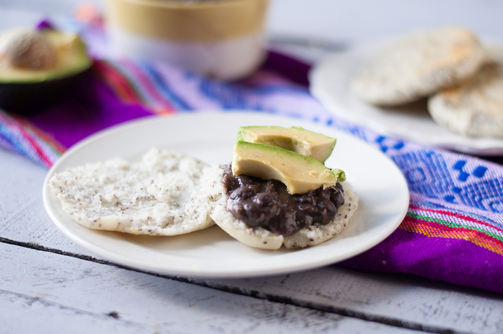 Chia Seed Arepas with beans and avocado are perfect any time of day! A protein packed plant-based meal! #vegan #glutenfree