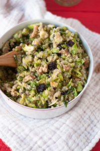 Brussel Sprout Quinoa Salad + Dried Cherries with an easy citrus based dressing. Perfect make ahead salad and makes a filling vegan lunch option! #vegan #fall #salad