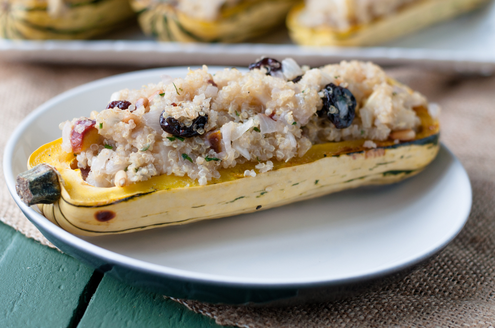 Roasted delicata squash stuffed with an apple and quinoa stuffing. Perfect for fall and a great vegan + gluten-free Thanksgiving option!