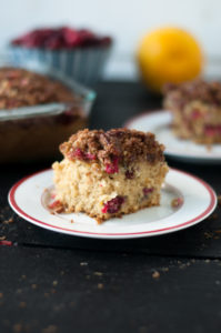 Seasonal twist on vegan coffee cake. Fresh cranberries and orange zest are the perfect pair in this fall and Thanksgiving inspired coffee cake. #vegan #thanksgiving