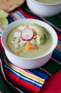 Pozole is a traditional Mexican soup that is served on special occasions and holidays. In this meatless version, butternut squash makes a hearty and satisfying soup. #vegan #mexican