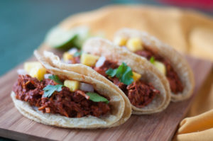 Slow Cooker Jackfruit Adobada Tacos. Jackfruit is slow cooked in flavorful chile sauce with pineapple. Perfect for taco tuesday. #vegan #mexican