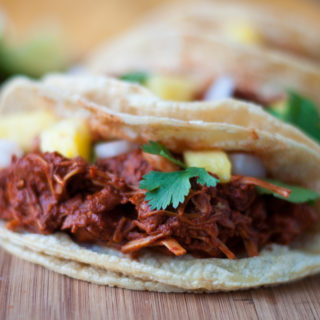 Jackfruit is slow cooked in a chile + citrus sauce with pineapple. Perfect for Taco Tuesday!