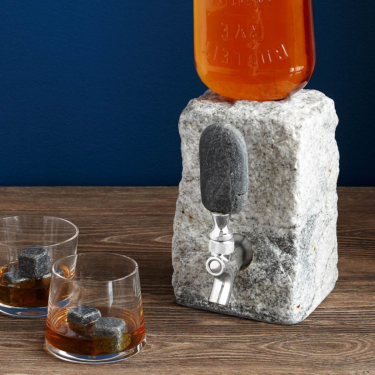 Stone Drink Dispenser Tap your favorite spirits in geologic style with Jeff Henderson's cobbled granite drink dispenser.