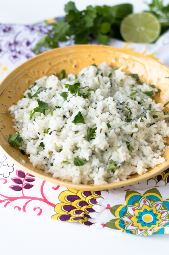 Rice is flavored with bright cilantro and lime juice. A delicious side dish to your taco night or in your burrito bowls.