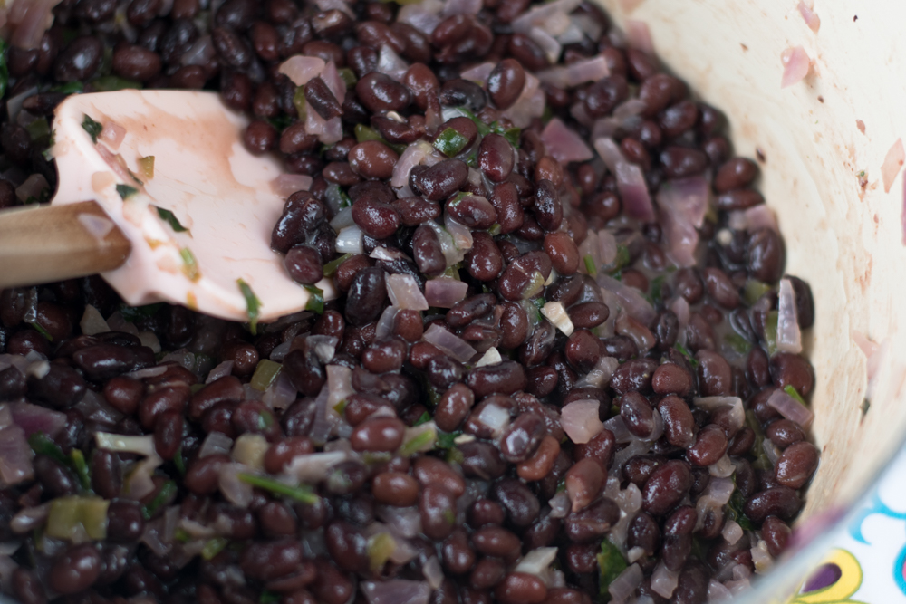 Black beans get a tropical twist. The beans are infused with coconut and fresh lime juice. An easy side dish and also great in burritos.