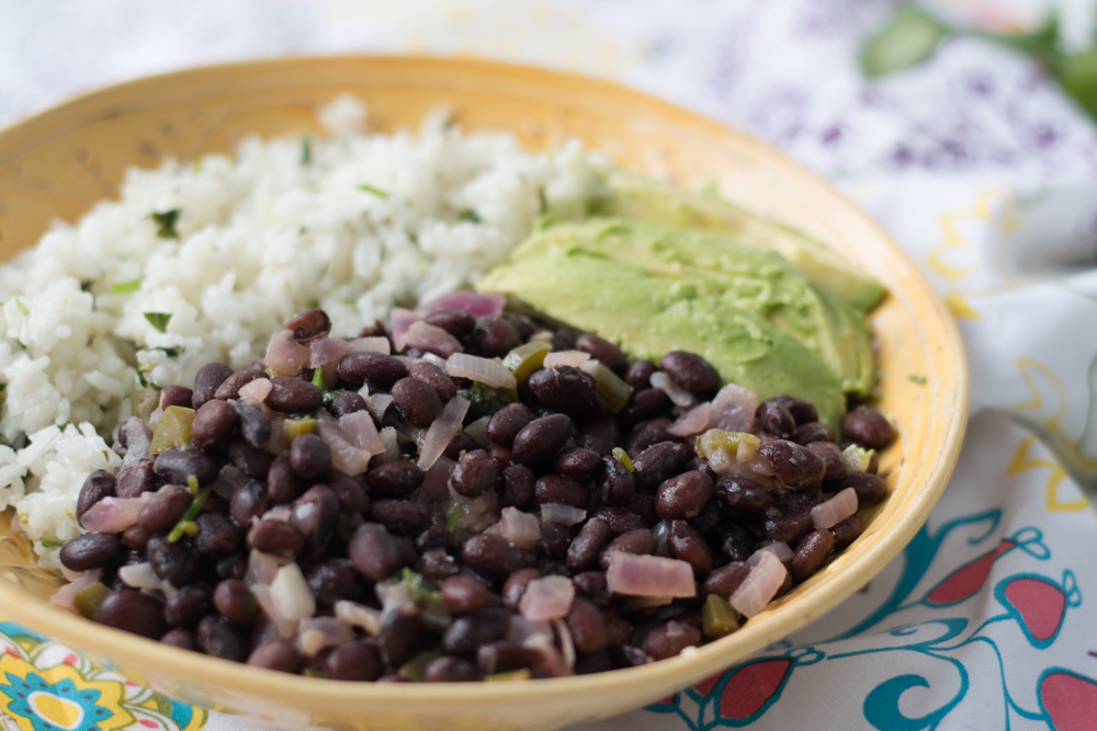 Tropical Coconut Lime Black Beans with cilantro lime rice & of course avocado make for a delicious burrito bowl!