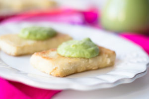 Citrus Tequila Tofu topped with an avocado salsa. The tofu is marinated in a bright, citrusy tequila marinade that is packed full of flavor.