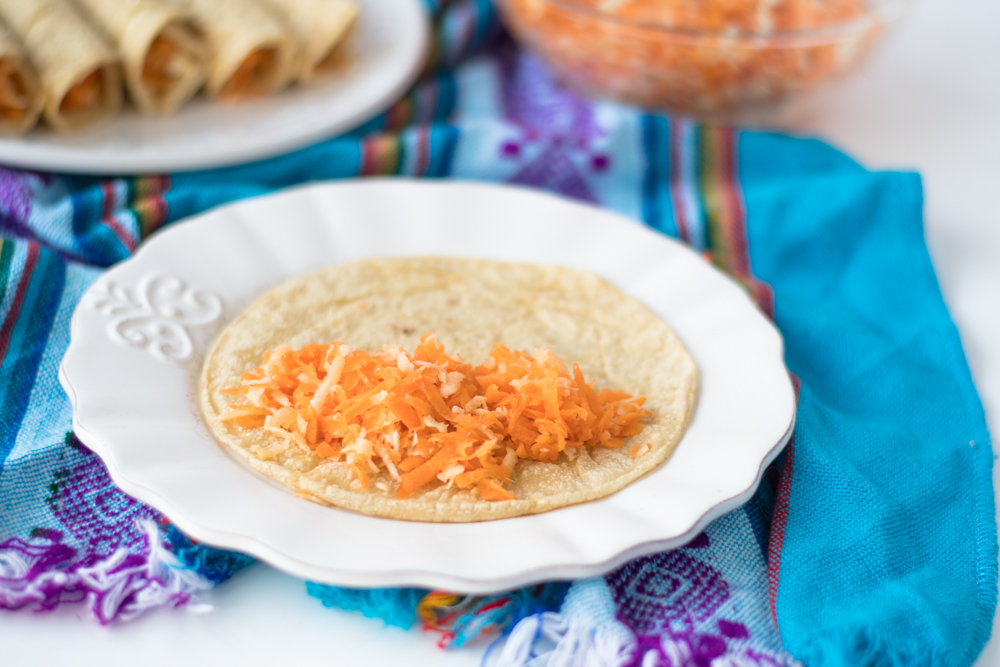 Corn tortillas are filled with a simple carrot and parsnip filling. Perfect for taco night!