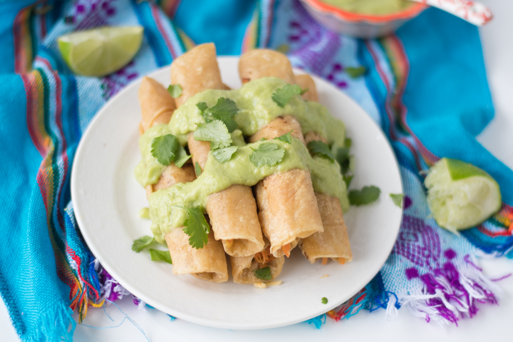 Switch up taco night for these amazing taquitos! Corn tortillas are stuffed with carrots and parsnips. So simple and delicious! #tacos #vegan