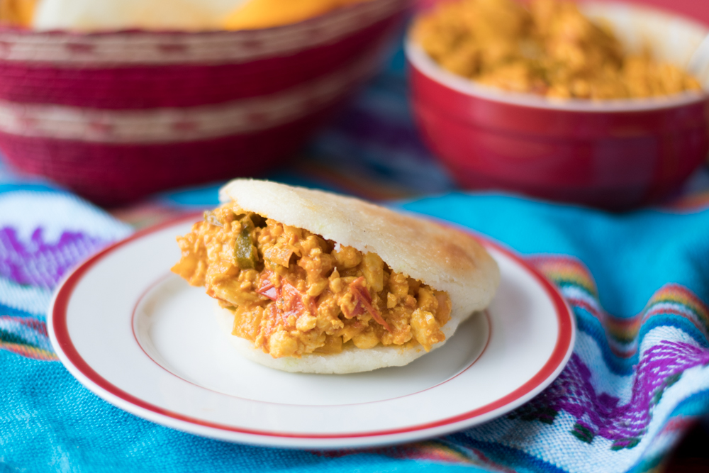 Vegan breakfast arepas are filling and delicious. A Venezuelan inspired tofu scramble is stuffed inside warn arepas.