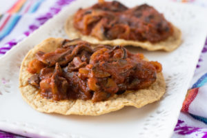 A vegan spin on traditional Mexican Tinga. Meaty portabella mushrooms are simmered in a delicious tomato and chipotle sauce. It's quick and easy too! #vegan #mexican