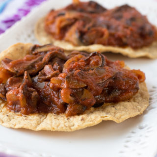 Quick & easy Mushroom Tinga Tostadas. Inspired by a classic Mexican tinga recipe. In this vegan, plant-based version mushrooms create that meaty texture. #vegan #mexican