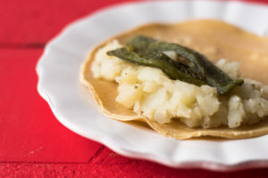 Potato and roasted poblano filled enchiladas. Inspired by Mexican papas con rajas.