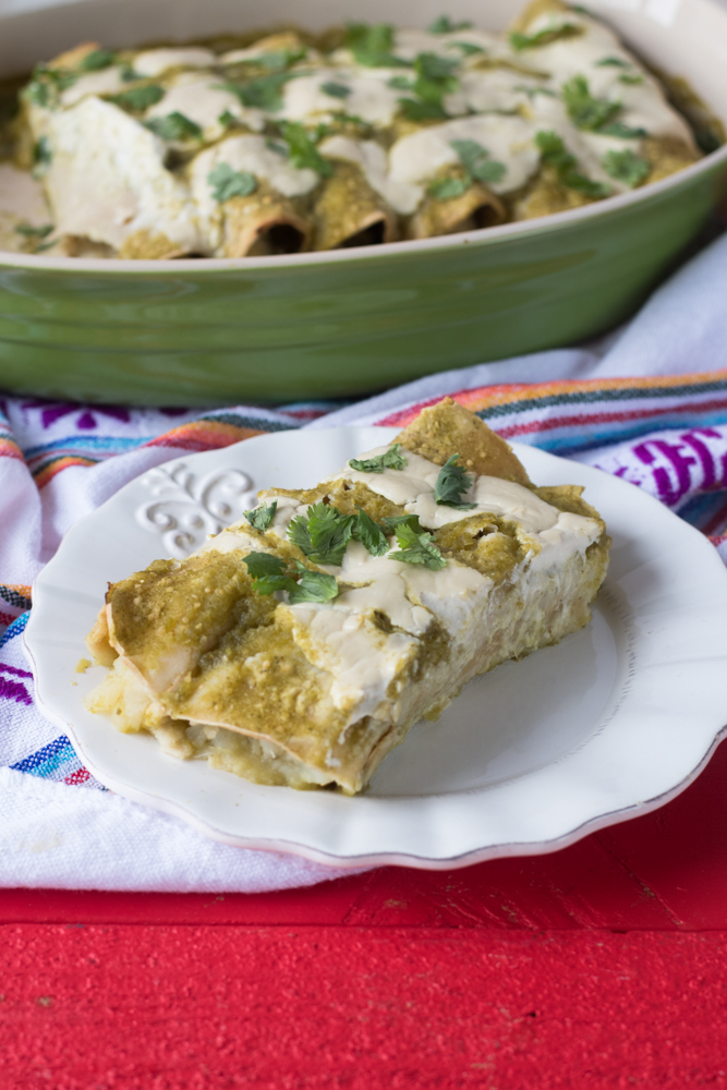 Potato and Roasted Poblano Enchiladas are a satisfying dinner option that everyone will love. Inspired by papas con rajas, these enchiladas have a spicy kick to them