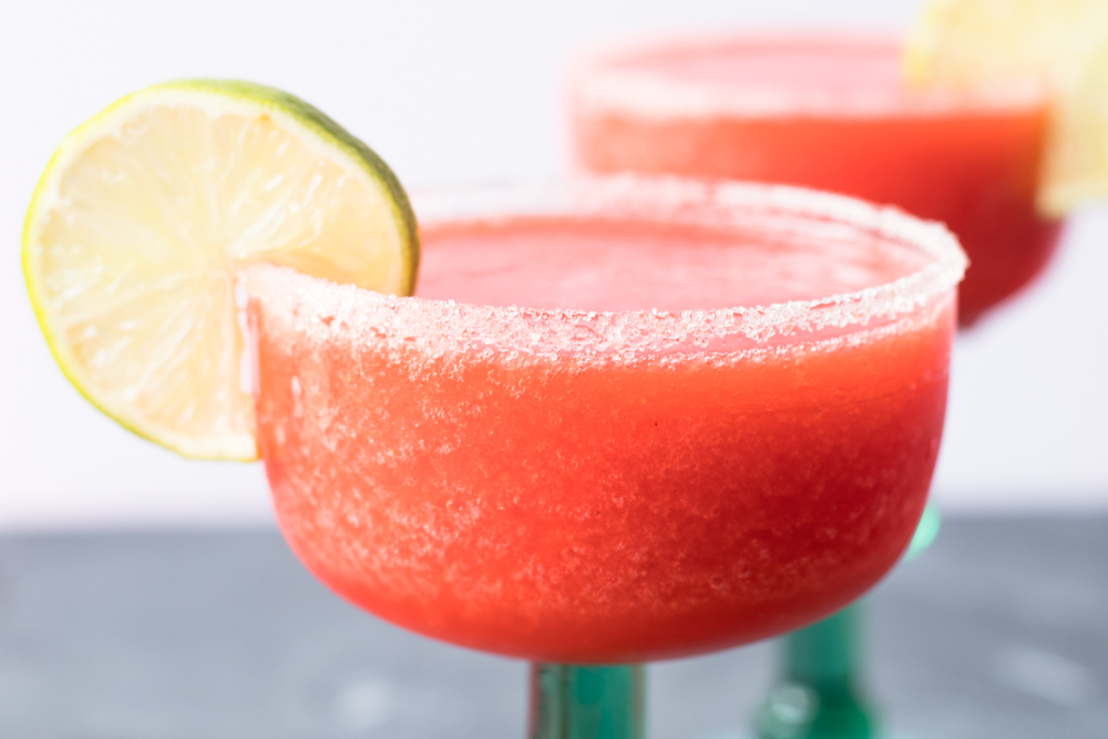 These sweet fruity Frozen Strawberry Margaritas are perfect for summer entertaining and Cinco de Mayo!